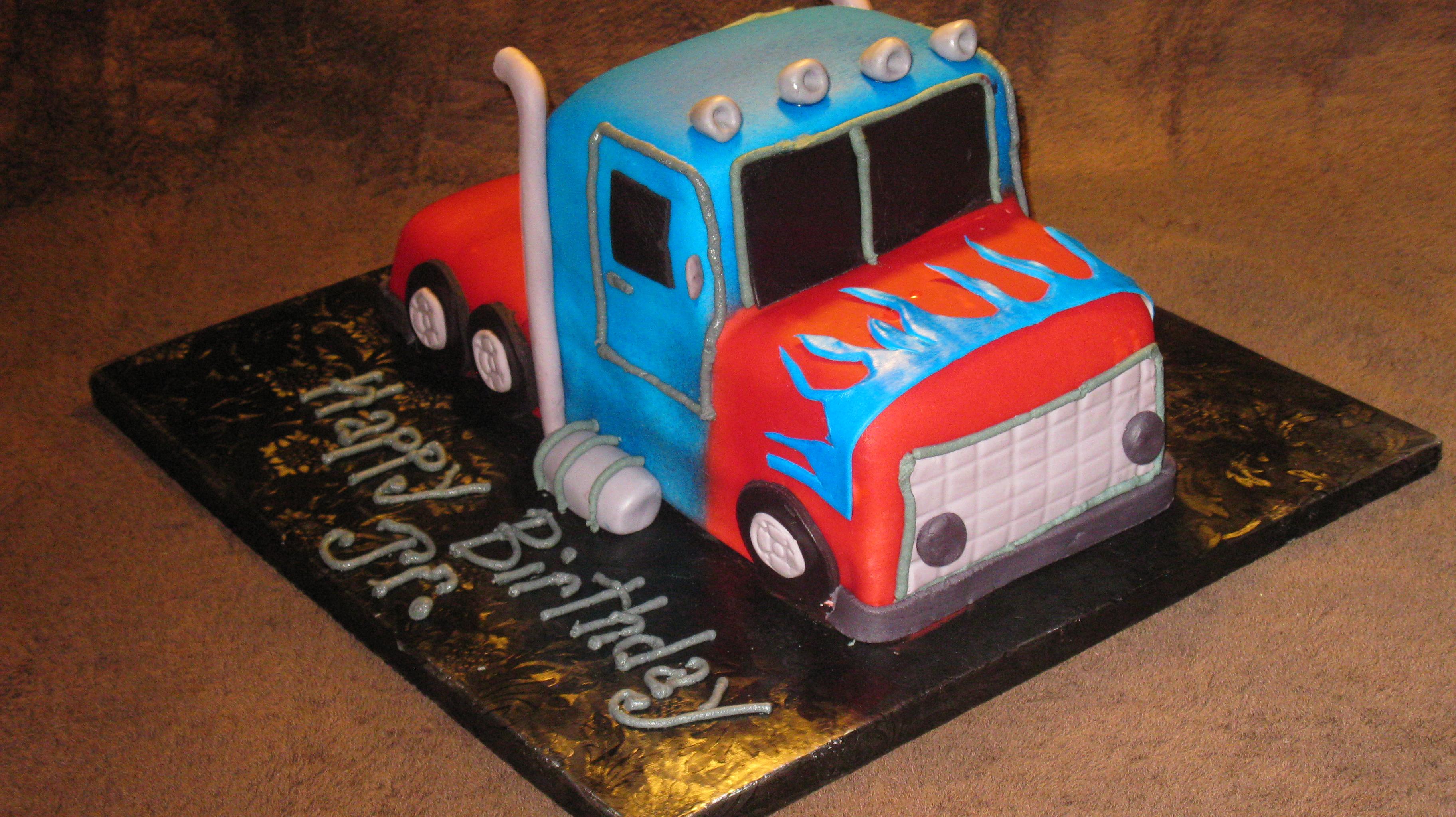 optimus prime transformer truck cake.jpg